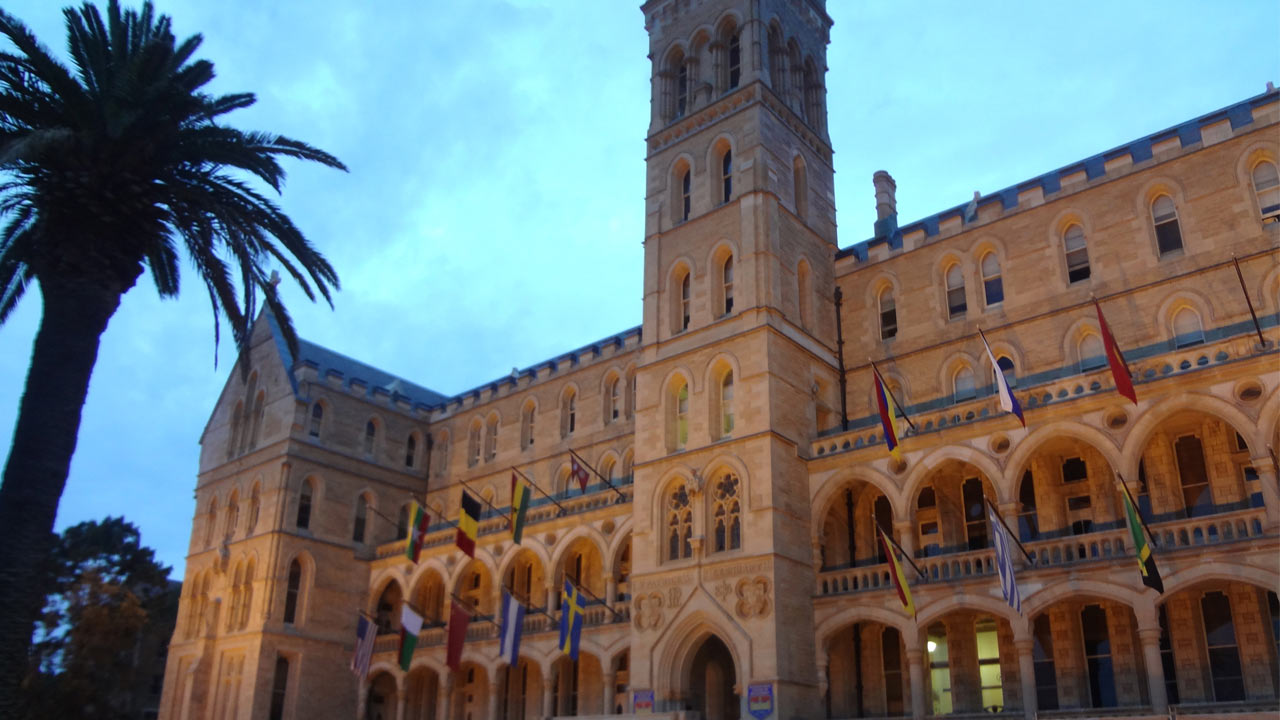 ICMS's ornate architecture showcased in the main entrance building at dusk