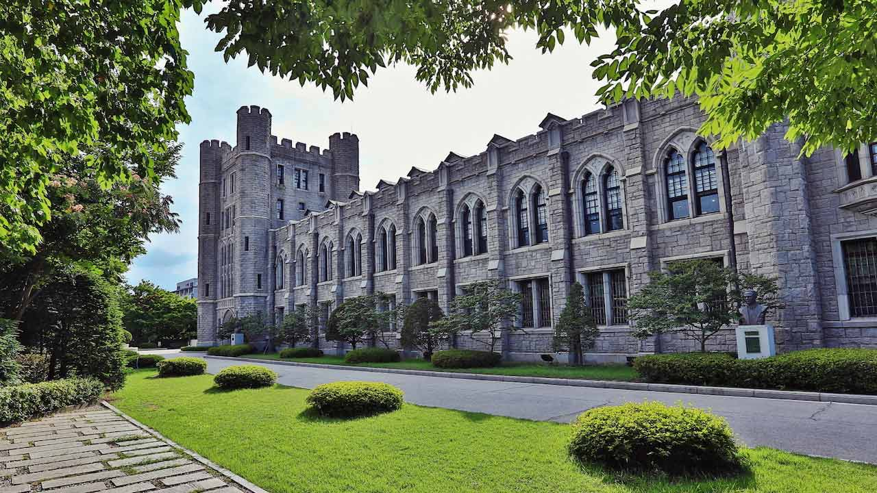 An ornate building on Korea University's campus surrounded by greenery