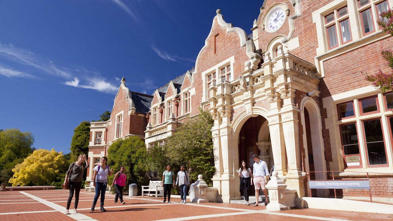 Students walk into a large, ornate building on Lincoln University campus