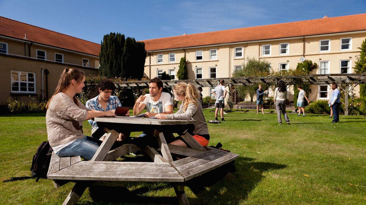 Students sit a picnic table on the quad on Lincoln University's campus