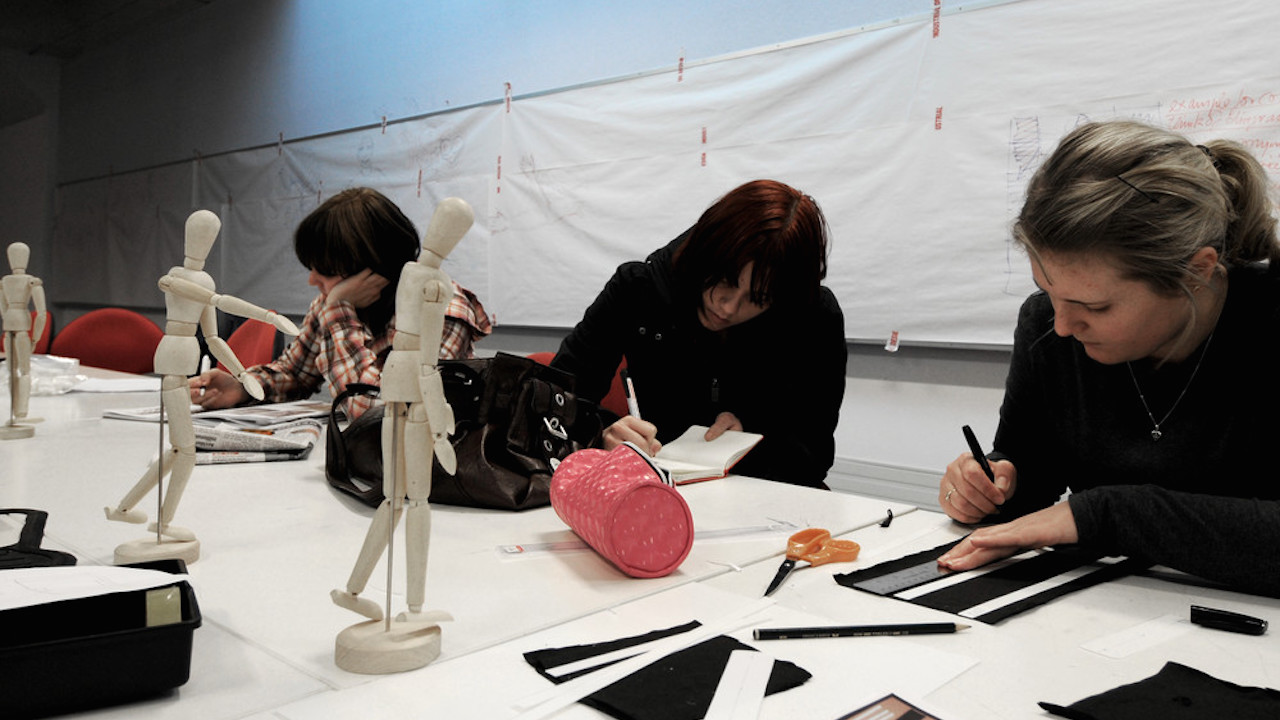 Students sit drawing still life of sculptures in class at Massey University Wellington's campus