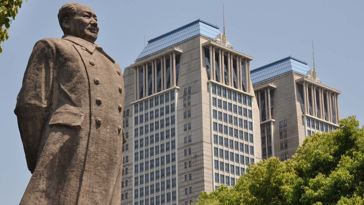 A statue and a building in Shanghai