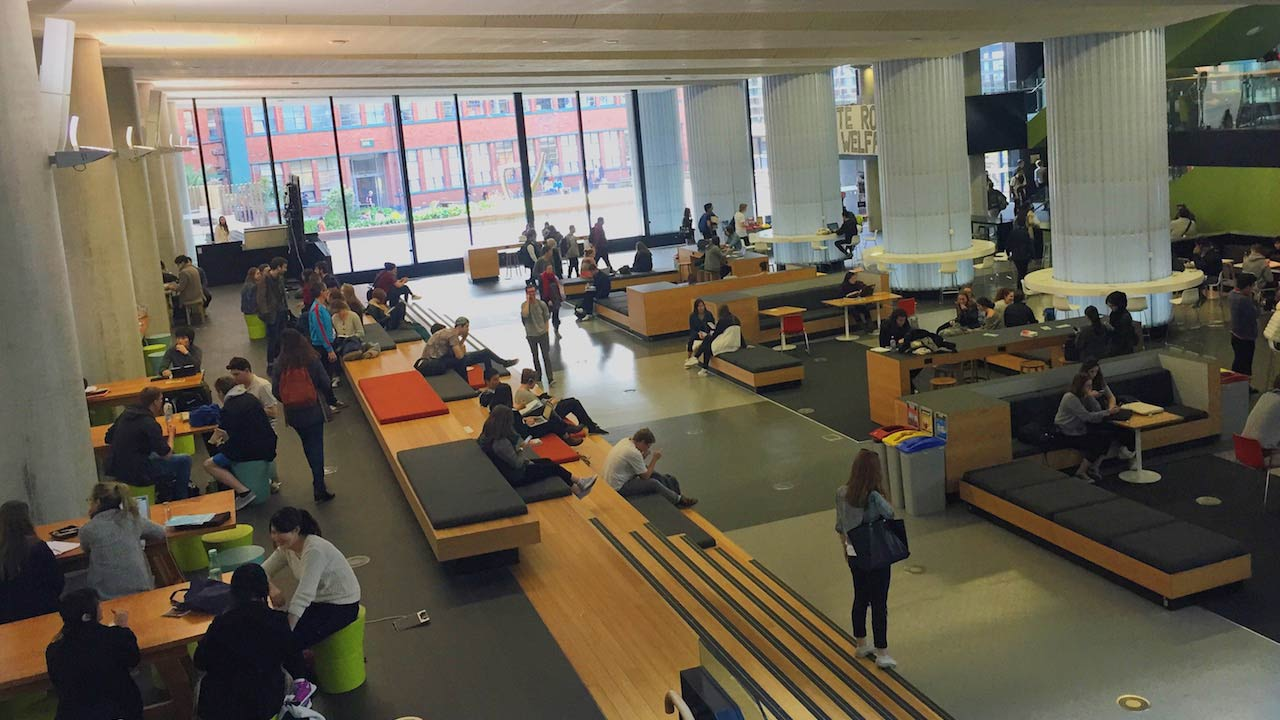 Students sit throughout a study room on Victoria University Wellington's campus