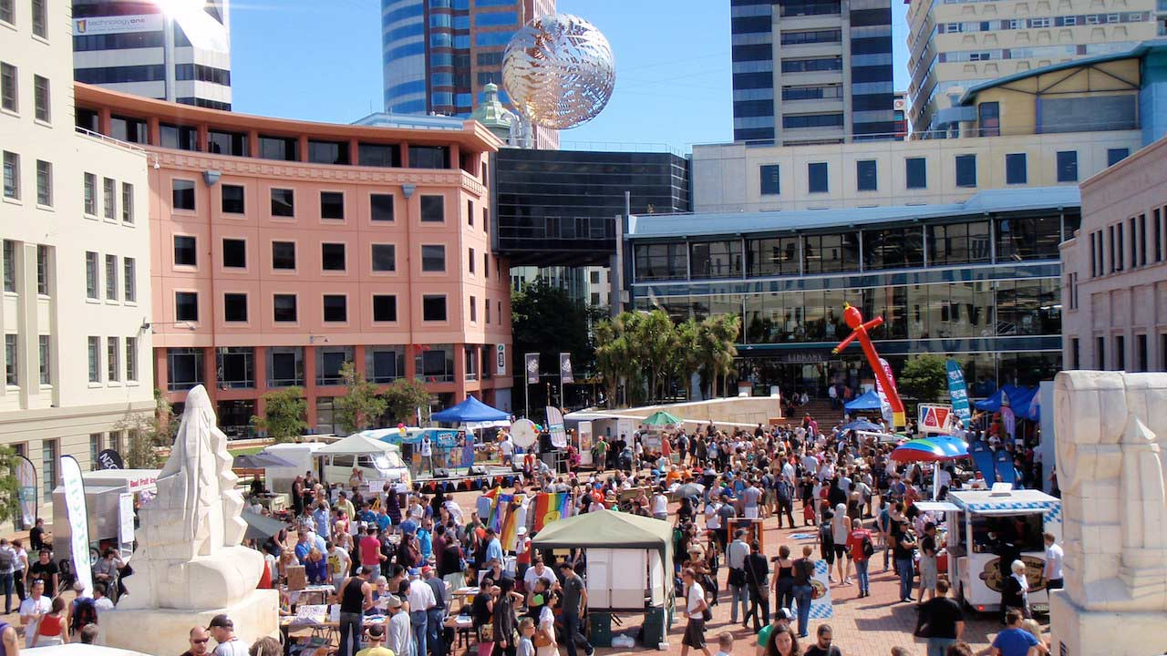 People gather in an outdoor space for a daytime festival in Wellington