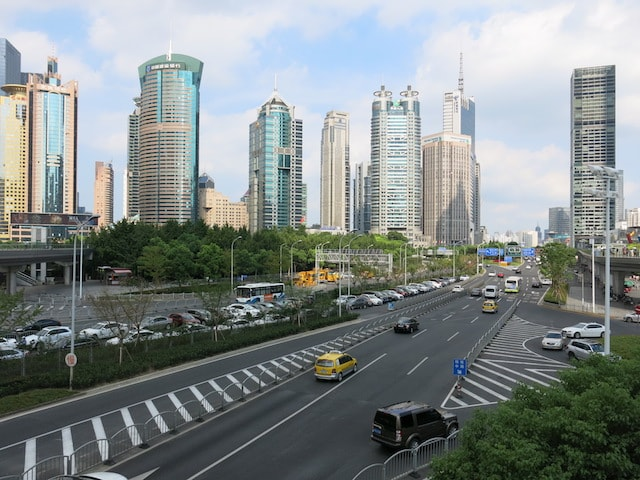 A highway in Shanghai with buildings in the background