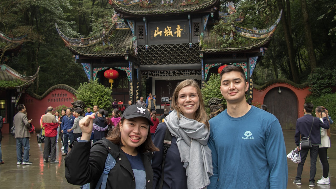 Three smiling TEAN students on the Chengdu Weekend Excursion