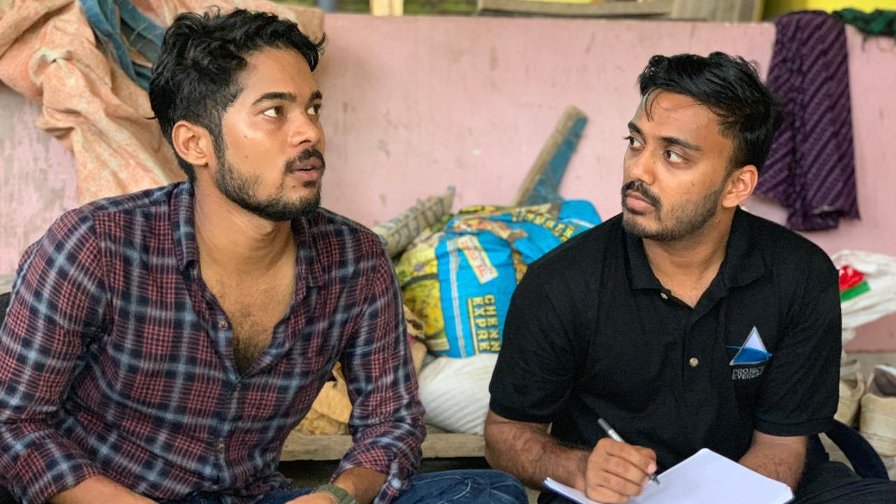 Two interns in India listening in meeting